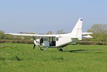 Ultralight Airplane On A Grass Strip