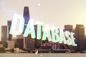 Double exposure of Database word sign on San Francisco city skyline background, global research and analytics concept