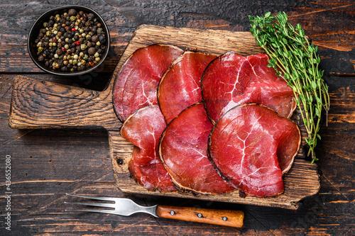 Fotografie, Obraz Italian Antipasti Bresaola cured meat beef cut pieces