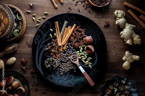 Fotografie, Obraz Top down view of an arrangement of dry ingredients against a dark background