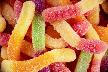 Colorful Jelly Marmalade Worms, Sweet Delicious Background. Light Sweet Dessert. Macro Photo.