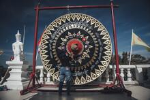 Big Gong Thai Called Khong At Wat Phu Thong Tthep Nimit  Temple Ban Nong Saeng, Udon Thani Province, Thailand. For People Visit And Respect Praying Buddha Statue