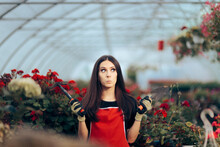 Stressed Greenhouse Worker Holding Gardening Tools
