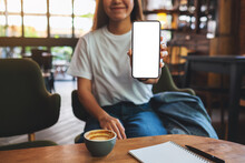 Mockup Image Of A Beautiful Woman Showing A Mobile Phone With Blank White Screen