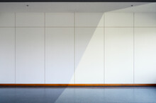 Empty Room Interior With Black Floor And White Wall Background. Free Space For Display Or Montage Products.