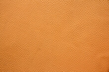 Close Up Of Orange Or Brown Leather Sheet Texture Background