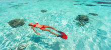 Snorkel Woman Swimming In The Turquoise Ocean Sea Relaxing Floating On Luxury Travel Vacation Above Underwater Coral Reefs. Water Sport Diving Active Lifestyle Banner.
