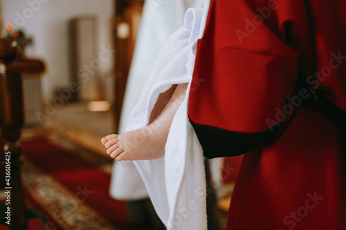 Obraz na plátně a baby's foot during a baptism ceremony in a Christian church