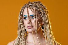 Young Charming Blonde With Exotic Braiding With Microdreads, Tinted Eyebrows,
