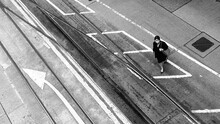 High Angle View Of Woman Wearing Mask Walking On Road In City