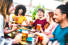 Young People Toasting Beer At Brewery Bar Rooftop - Friendship Life Style Concept With Young Milenial People Enjoying Happy Hour Time Together At Penthouse Terrace Pub