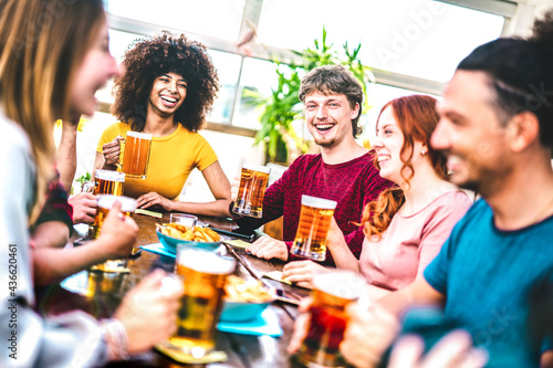 Fotografie, Obraz Young people toasting beer at brewery bar rooftop - Friendship life style concep