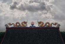 Detail Of Rooftop Of Chinese Shrine And Temple In Bangkok, Thailand With Dramatic Sky At Sunset