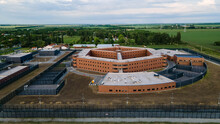 Aerial View Of A European Jail Or Prison. Drone View Of Penitentiary Prison. Aerial View Of Penitentiary Prison And Detention Center Near City.