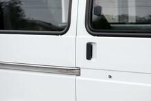 White Metal Door Of A Minibus.