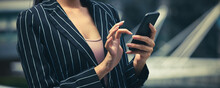 Banner Of  Businesswoman Hand With Smartphone For Work And  Paying  Debt Of Bill In The Office