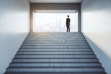Business Success With Back View On Businessman Standing At The Top Of Stairs In Abstract Light Walls Building And Looking At Foggy City Skyscrapers.
