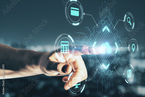 Modern cloud technology and computing concept with man finger on digital touch screen with cloud icon surrounded by internet technology symbols.
