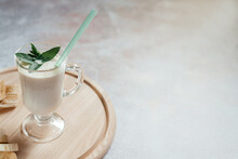 Milk Banana Shake Decorated With Mint Leaves In A Latte Glass With A Handle On Light Background With Copy Space