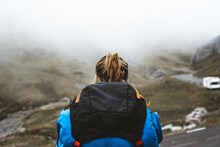 Enthusiastic Traveler Standing On Top And Looking At Mountains In Foggy Haze