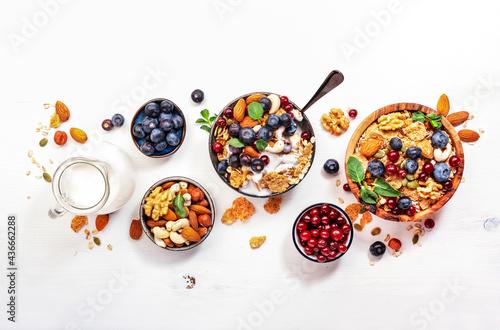 Muesli bowl and organic ingredients for healthy breakfast Fototapeta
