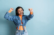Leinwandbild Motiv Young asian woman in headphones dancing and singing at camera