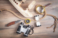 Wooden Toy Ship, Compass, Rope, Binoculars, Magnifying Glass, Hourglass, Knife. Travel