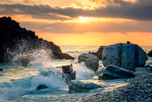 Stormy Sea Waves Splash Up To The Sky With Sun. Sunset At Sea. Storm. Seascape.