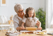 Leinwandbild Motiv family are preparing bakery together