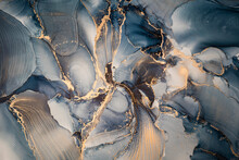 High Resolution. Luxury Abstract Fluid Art Painting In Alcohol Ink Technique, Mixture Of Dark Blue, Gray And Gold Paints. Imitation Of Marble Stone Cut, Glowing Golden Veins. Tender And Dreamy Design.