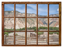 Cattle Corral In Arid Landscape Of North Western Colorado As Seen From A Vintage Cabin Window
