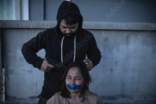 Canvas Businesswoman is hostage from bandit, Hostage of terrorist man concept, Thailand