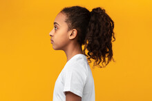 Side View Profile Portrait Of Serious African American Girl