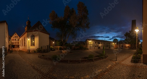 Fotografiet View of the historic protestant church of Walldorf in hesse during sunset