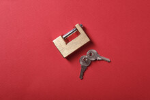 Metal Yellow Padlock On A Red Background, Top View