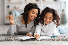 Creative African American Family Coloring Together At Home