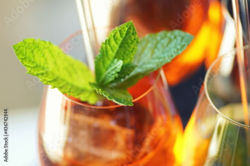 Fototapeta close up of colorful aperitive summer drinks with glass straws