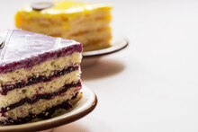 Close-up Of A Piece Of A Berry Cake. Lemon Cake In The Background.