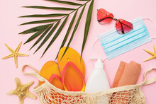 Chico Leaf, Sunglasses, Beach Slippers And Medical Mask On Pink Background