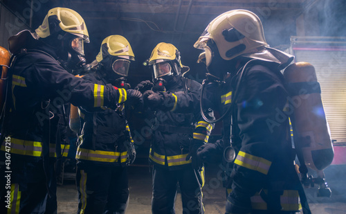 Canvas Print Group of firemen in the fire department organizing action plan for safe executio