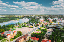 Rechytsa, Belarus. Aerial View Of Residential Houses And Famous Landmarks Of Town: Holy Assumption Cathedral And Holy Trinity Church In Sunny Summer Day.