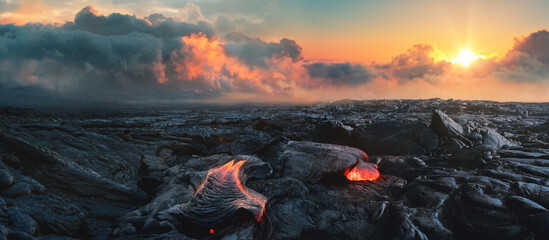 Lava Field under sunset clouds on background