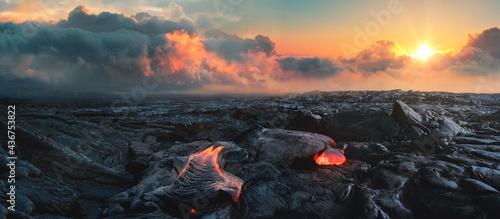 Fotografiet Lava Field under sunset clouds on background