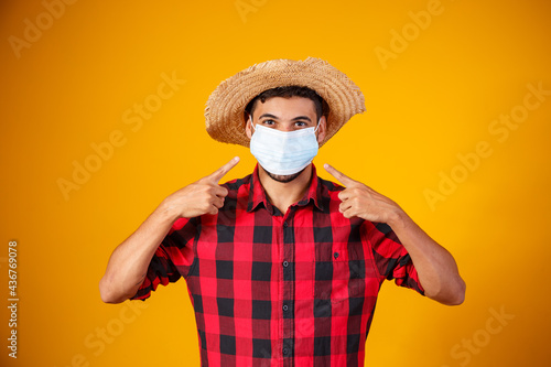 man in typical clothes of famous Brazilian party called Festa Junina in celebration of São João Fotobehang