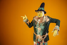 Photo Of Scarecrow Character From Festa Junina On Yellow Background With Space For Text
