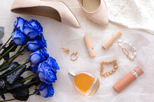 Beautiful Blue Roses, Cosmetic And Wedding Dress On Light Background