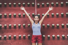 Happy Asia Travel Fun Young Asian Tourist Woman With Arms Up Excited On Summer Vacation At Old Red Wooden Gate Temple Background, China Travel. Chinese Girl Tourist Enjoying Summer Holidays.