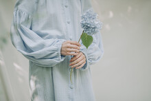 Full Length Of Woman Holding White Flower