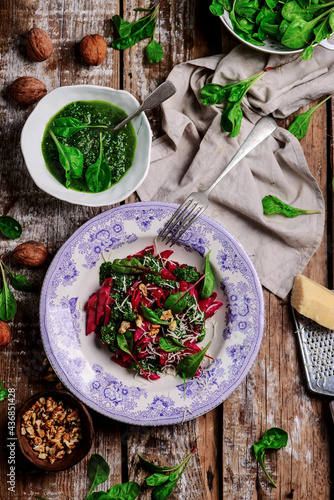 Wallpaper Mural Beet pasta with spinach pesto .style rustic