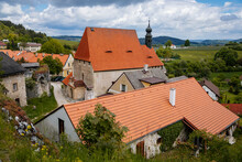 Village Near Ruins Of Gothic Castle Rabi In National Park Sumava, Church Of The Holy Trinity With A Tower, Landmark In Countryside, Red Tiled Roof, Rabi, Czech Republic